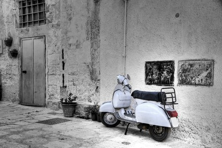 White scooter in corner alleyway. Monopoli. Apulia.