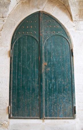 rustiness: Ancient green door.