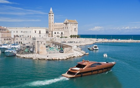 apulia: Touristic port with Cathedral and luxury yacht. Trani. Apulia. Stock Photo