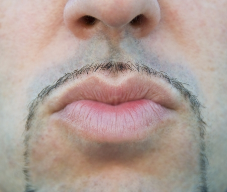 Close up of a man lips sending a kiss. photo