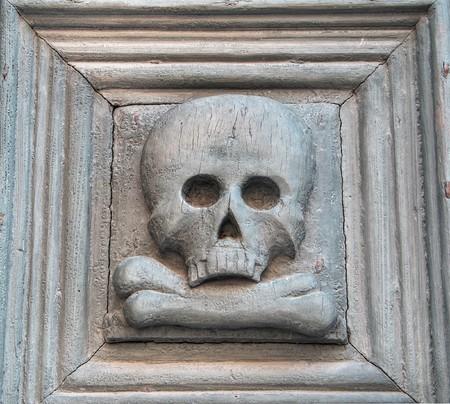 mortality: Portal with skull. Purgatory Church. Matera. Basilicata.