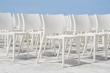 White chair group on blue sky. Imagens