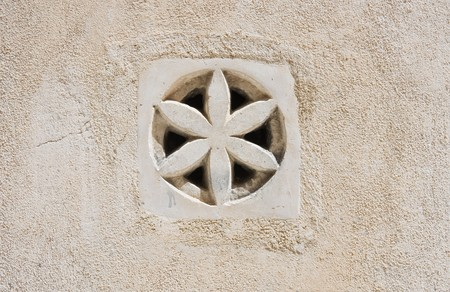 Decorated wall with air hole. photo