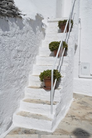 roofed house: Close up of a Trullo Staircase. Alberobello. Apulia.