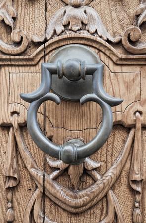 Doorknocker on allwood door. photo
