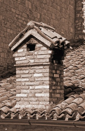 roofed house: Close up of a chimney-pot.