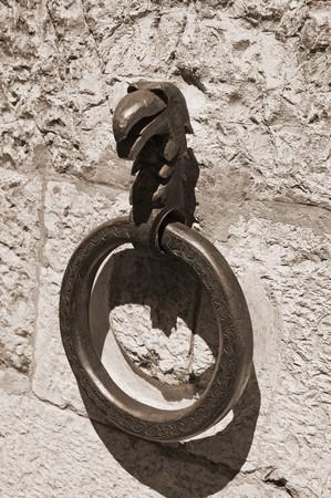 rustiness: Iron ring wall.