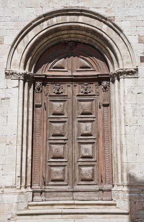 ss: SS. Trinit� Church. Wooden Portal. Gubbio. Umbria. Stock Photo
