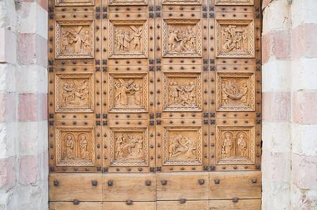 wood panelled: St. Croce Portal Church. Bastia Umbra. Umbria.