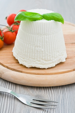 Ricotta cheese with basil leaves. photo