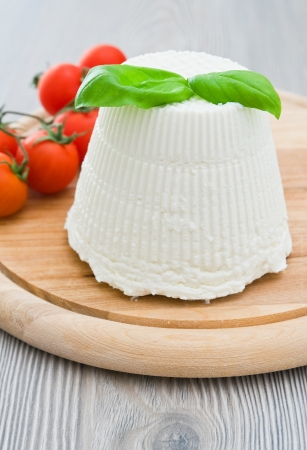 Ricotta cheese with basil leaves.