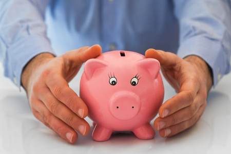 repayment: Man with piggy bank. Stock Photo