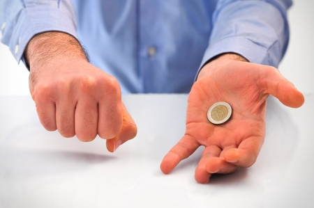 Man playing with euro coin. photo