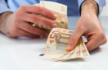 handle: Man handling money. Stock Photo