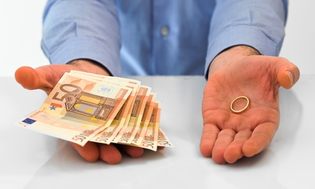 Man with wedding ring and money. photo