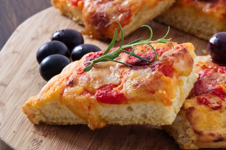 focaccia: Focaccia with tomato and black olives. Stock Photo
