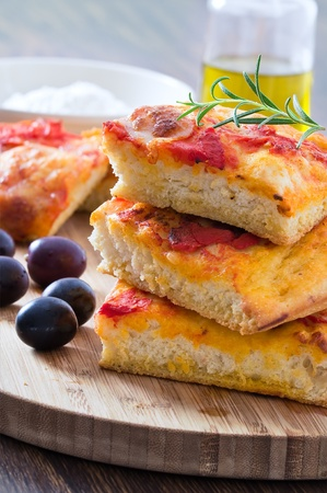 Focaccia with tomato and black olives. Stock Photo - 12137687