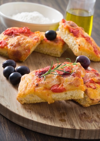 Focaccia with tomato and black olives. photo