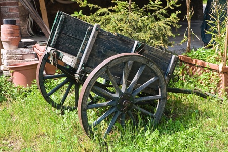 a two wheeled vehicle: Wooden handcart.
