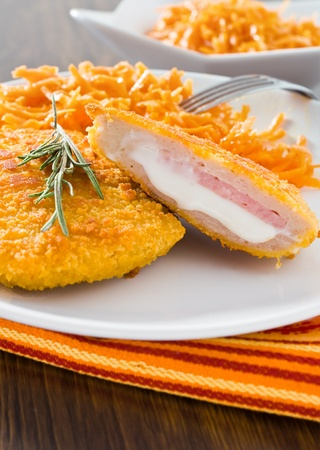 Chicken cordon bleu with grated carrots. photo