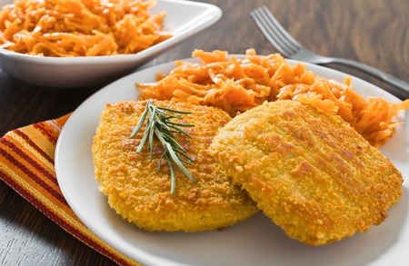 Chicken cordon bleu with grated carrots. Imagens - 12137805