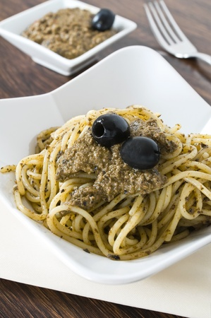 Spaghetti with black olive pesto. photo