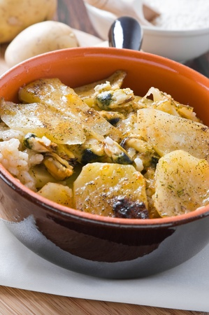 Tiella of potatoes, rice and mussels. Stock Photo - 12394793
