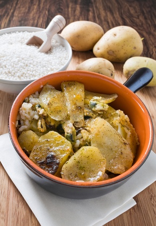 Tiella of potatoes, rice and mussels. photo