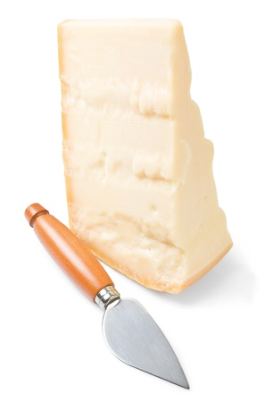 Parmesan cheese piece with knife. photo