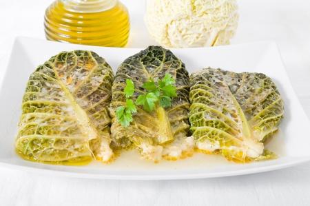 savoy cabbage: Savoy cabbage rolls on white dish
