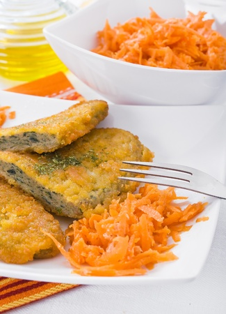 Spinach cutlet on white dish  photo