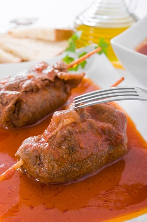 Meat roulade on white dish. photo