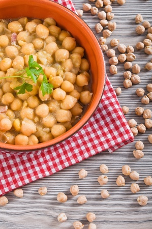 Chickpea soup in terracotta bowl  photo