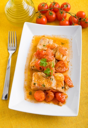 Fish and cherry tomatoes. photo