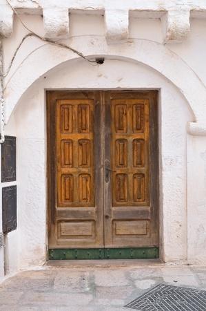 wood panelled: Alleyway  Cisternino  Puglia  Italy