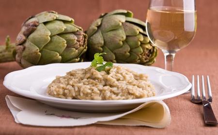 risotto: Risotto with artichokes. Risotto ai carciofi. Stock Photo