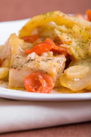 Fish, cherry tomatoes and potatoes. photo