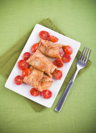 Eggplant roulades with cherry tomato salad.  photo