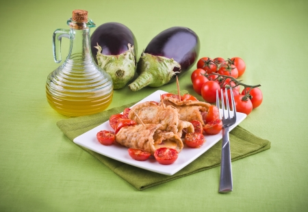 Eggplant roulades with cherry tomato salad. Stock Photo - 13707493