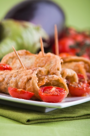 Eggplant roulades with cherry tomato salad.  photo