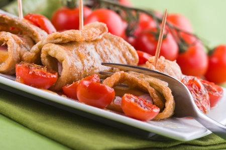 Eggplant roulades with cherry tomato salad. Stock Photo - 13707484