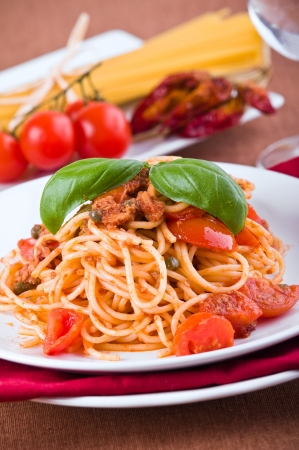 Spaghetti with tuna, cherry tomatoes and capers.  photo