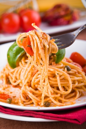 Spaghetti with tuna, cherry tomatoes and capers.  photo