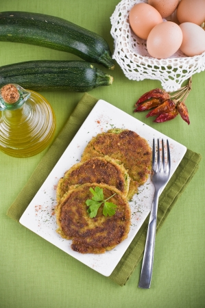 Zucchini omelettes. photo