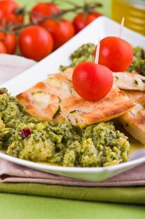 Zucchini focaccia with broccoli. photo