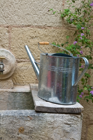 washhouse: Watering can on washhouse  Stock Photo