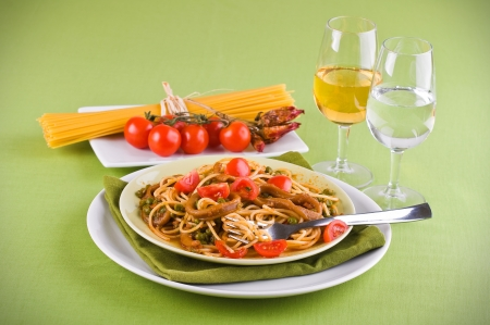 Spaghetti with squids, peas and cherry tomatoes  photo