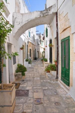 urbanistic: Alleyway. Ostuni. Puglia. Italy. Stock Photo