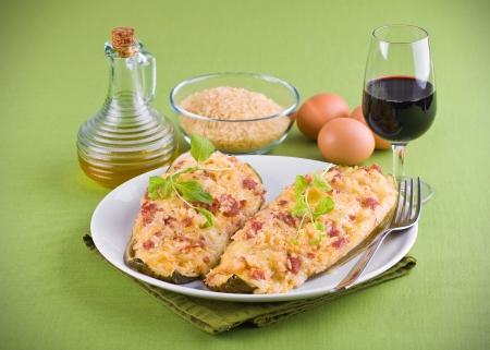 Stuffed zucchini halves. photo
