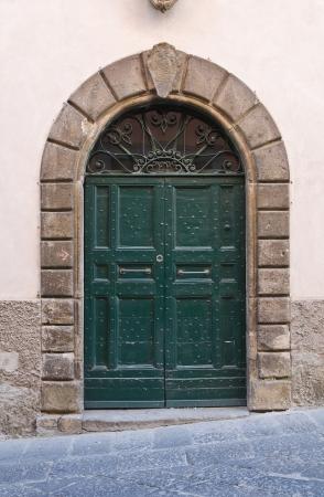 Wooden door. Tuscania. Lazio. Italy. photo